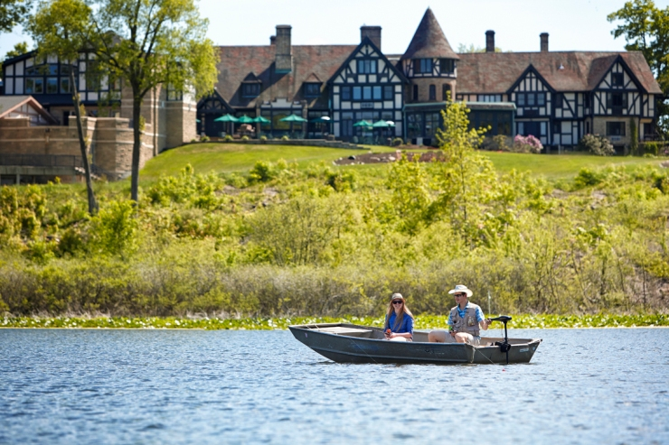 OSPL_PM-Couple-in-boat-with-Manor-House-background.jpg